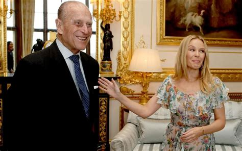 Prince Philip turns on the charm as he meets Kylie Minogue