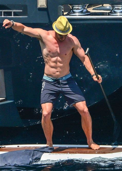These Pictures of Shirtless Chris Hemsworth Paddle
